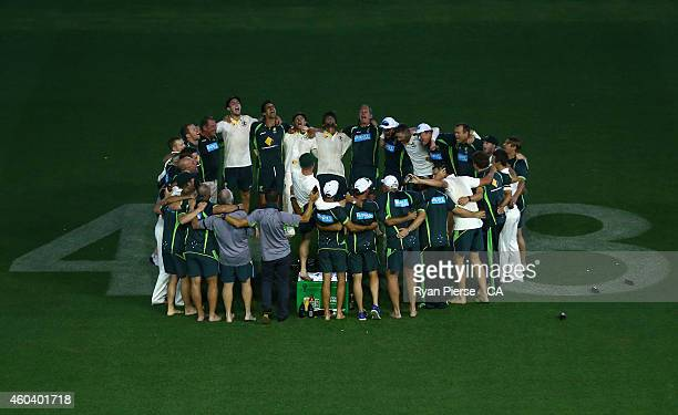The Australian Cricket Team sing their team song over the '408' in a tribute to the late Phillip Hughes during day five of the First Test match...