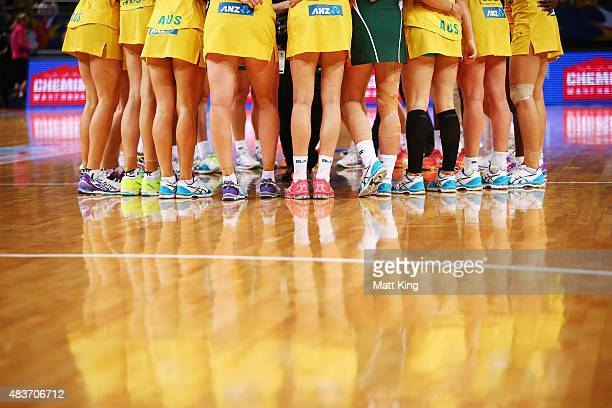 The Australian Diamonds form a huddle after winning the 2015 Netball World Cup Qualification round match between Australia and South Africa at...
