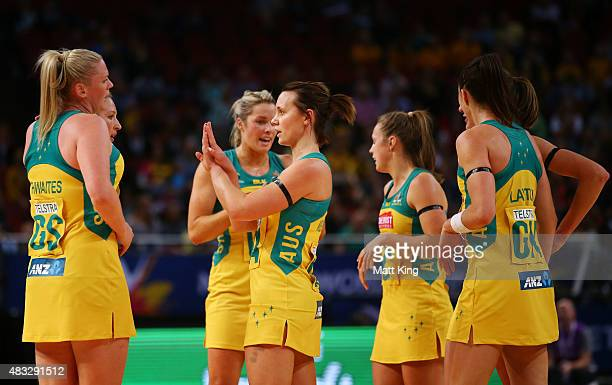 The Australian Diamonds form a huddle on court during the 2015 Netball World Cup match between Australia and Trinidad Tobago at Allphones Arena on...