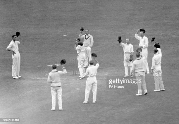 The Australian fielders form a circle around Hobbs as he arrives to open England's second innings on the Fourth Day of their Test Match at the Oval...