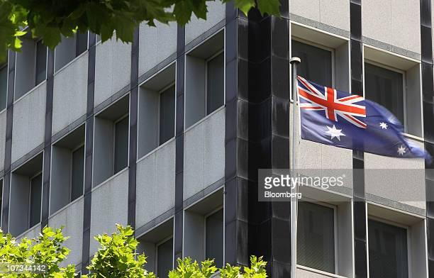 The Australian flag flies outside the Reserve Bank of Australia headquarters in Sydney Australia on Friday Dec 3 2010 The Reserve Bank of Australia...