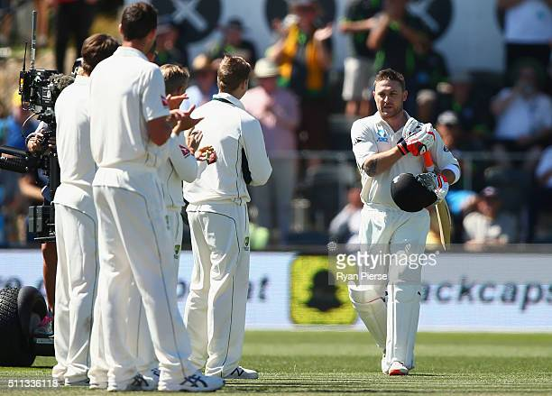 The Australian form a guard of honor as Brendon McCullum of New Zealand walks out to bat in his final test match during day one of the Test match...