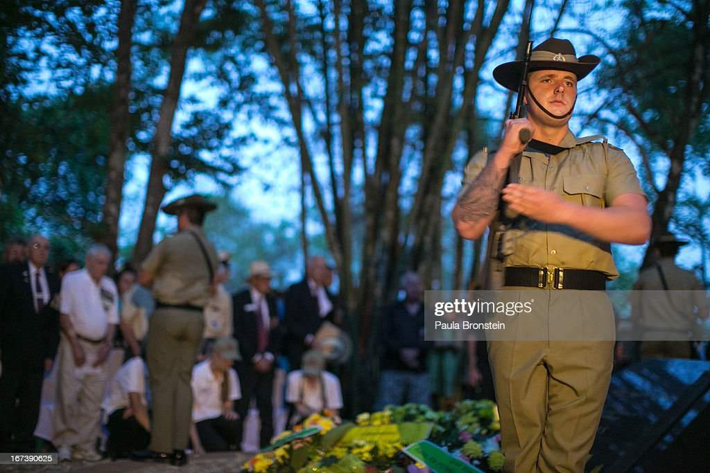 The Australian honor guard stands at attention during a sunrise memorial service in remembrance of all those who lost their lives April 25, 2013 in Hellfire Pass, Thailand. Hellfire Pass is a small section of the Burma-Thailand railway which was built by POW's and Asian Laborers under horrific conditions during the Second World War (WWII). Heavy loss of life was suffered during construction due to disease, starvation and exhaustion.