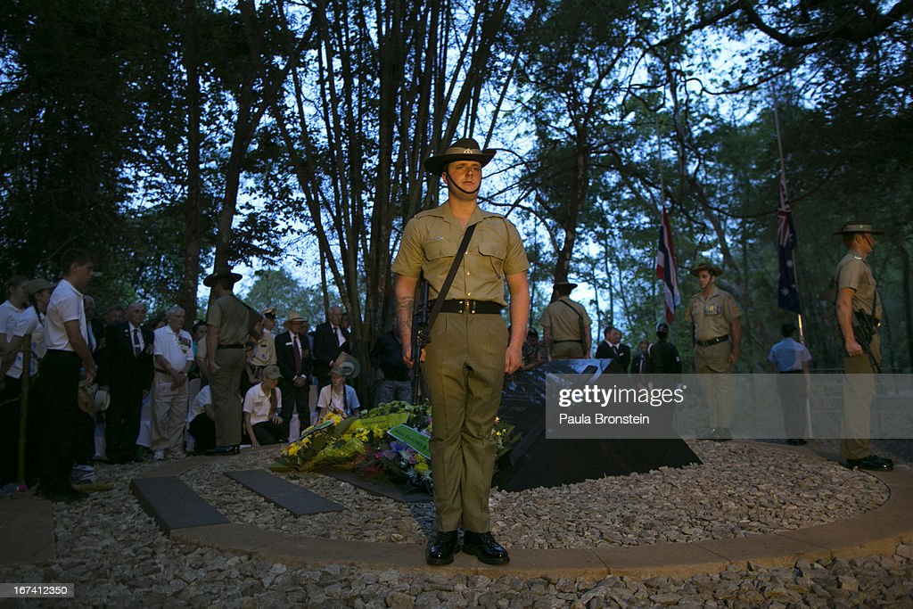 The Australian honor guard stands at attention during the sunrise memorial service in remembrance of all those who lost their lives, on April 25, 2013 in Hellfire Pass, Thailand. Hellfire Pass is a small section of the Burma-Thailand railway which was built by POW's and Asian Laborers under horrific conditions during the Second World War (WWII). Heavy loss of life was suffered during construction due to disease, starvation and exhaustion.