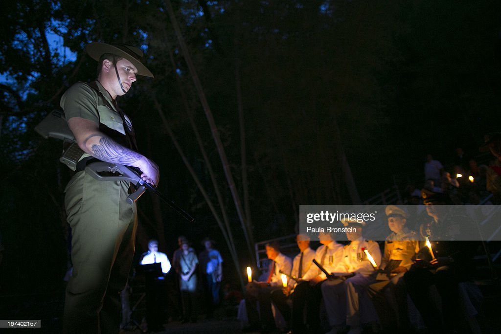 The Australian honor guard stands in prayer during a sunrise memorial service in remembrance of all those who lost their lives April 25, 2013 in Hellfire Pass, Thailand. Hellfire Pass is a small section of the Burma-Thailand railway which was built by POW's and Asian Laborers under horrific conditions during the Second World War (WWII). Heavy loss of life was suffered during construction due to disease, starvation and exhaustion.