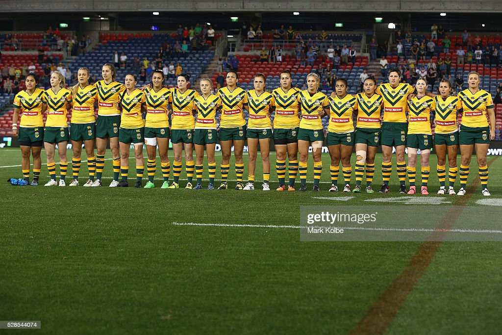 The Australian Jillaroos sing the national anthem during the Women's international Rugby League Test match between the Australian Jillaroos and New Zealand Kiwi Ferns at Hunter Stadium on May 6, 2016 in Newcastle, Australia.