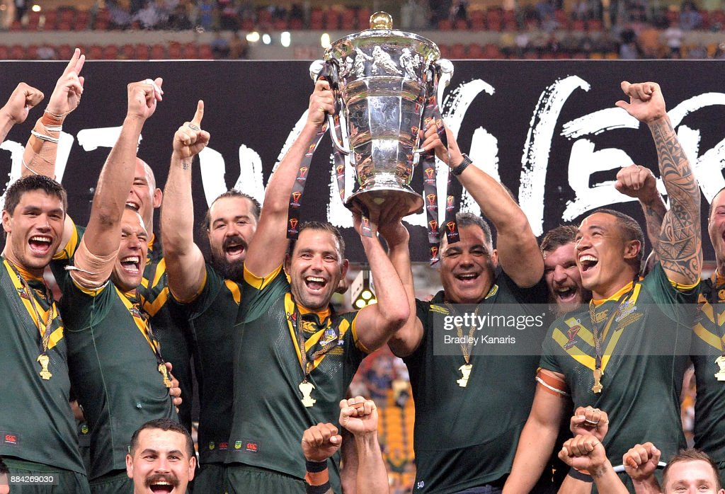 The Australian Kangaroos celebrate victory as captain Cameron Smith holds up the world cup trophy after the 2017 Rugby League World Cup Final between the Australian Kangaroos and England at Suncorp Stadium on December 2, 2017 in Brisbane, Australia.