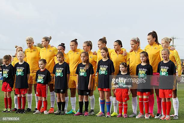 The Australian Matildas look on during the Australian National Anthem before the women's international friendly match between the Australian Matildas...