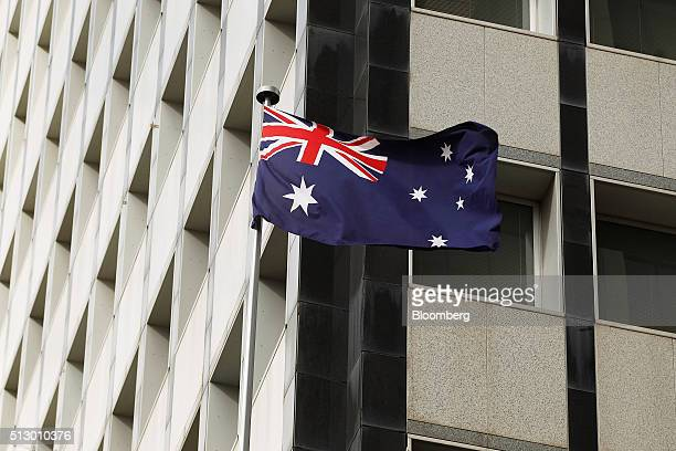 The Australian national flag flies in front of the Reserve Bank of Australia headquarters in Sydney Australia on Monday Feb 29 2016 Australian wage...