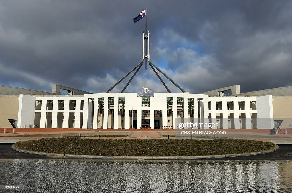 The Australian national flag flies over Parliament House in Canberra on June 20 2011 The building was designed by Mitchell/Giurgola Architects and...