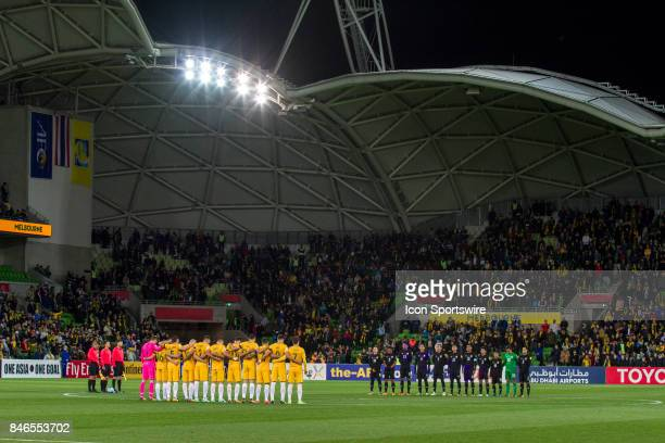 The Australian National Football Team and The Thailand National Football Team stand in silence before the FIFA World Cup Qualifier Match Between the...