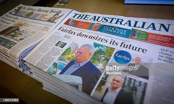 The Australian newspaper published by News Ltd right is displayed for sale next to the Sydney Morning Herald published by Fairfax Media Ltd at a news...