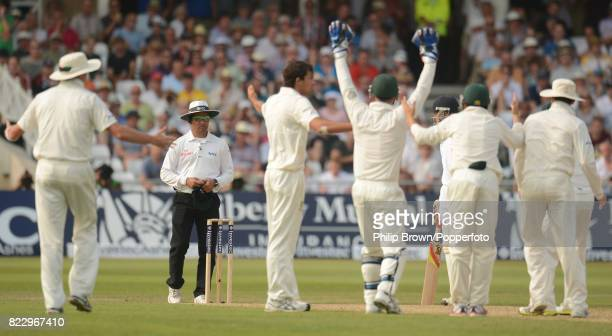 The Australian players appeal in vain to umpire Aleem Dar for the dismissal of England's Stuart Broad off the bowling of Australia's Ashton Agar...