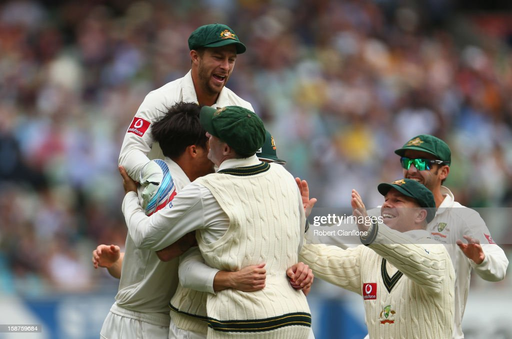 The Australian players celebrate the wicket of Tillakaratne Dilshan of Sri Lanka after he was caught by Ed Cowan off the bowling of Mitchell Johnson during day three of the Second Test match between Australia and Sri Lanka at Melbourne Cricket Ground on December 28, 2012 in Melbourne, Australia.