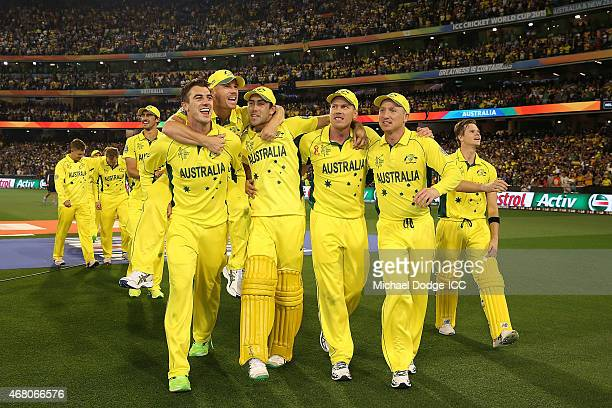 The Australian players celebrate winning during the 2015 ICC Cricket World Cup final match between Australia and New Zealand at Melbourne Cricket...