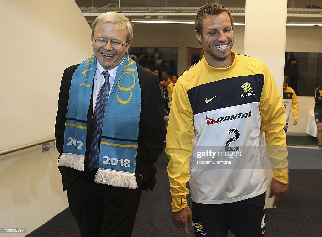 The Australian Prime Minister Kevin Rudd and Australian Socceroos captain Lucas Neill walk onto the pitch during an Australian Socceroos training session at AAMI Park on May 20, 2010 in Melbourne, Australia.