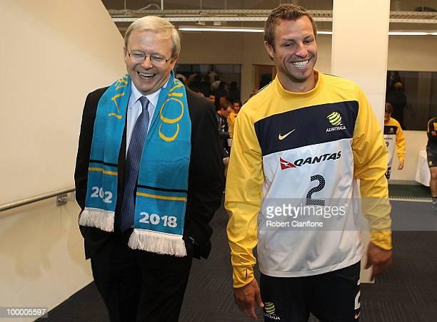 The Australian Prime Minister Kevin Rudd and Australian Socceroos captain Lucas Neill walk onto the pitch during an Australian Socceroos training...