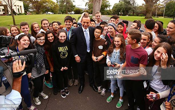 The Australian Prime Minister Tony Abbott stops his motorcade to pose for photos and chat with Overnewton Anglican Community College students after...
