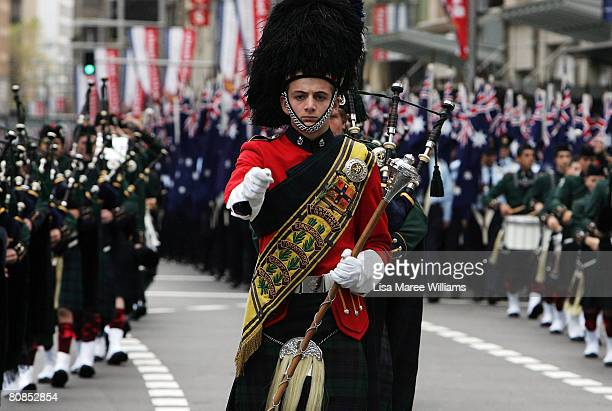 The Australian Scots College Pipes Drums band march along George Street during Anzac Day Commemorations on April 25 2008 in Sydney Australia ANZAC...