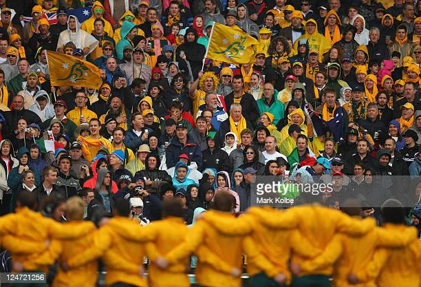 The Australian supporters in the crowd sing as the Wallabies line up for the national anthem during the IRB 2011 Rugby World Cup Pool C match between...