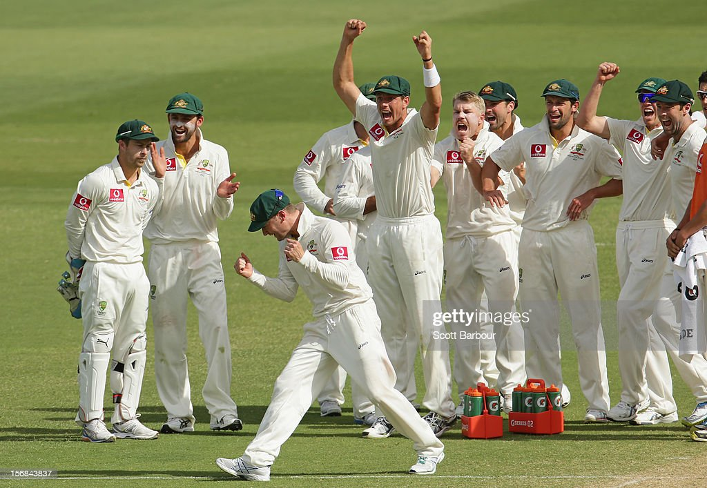 The Australian team celebrate as the third umpire confirms the dismissal of Hashim Amla of South Africa during day two of the Second Test match between Australia and South Africa at Adelaide Oval on November 23, 2012 in Adelaide, Australia.