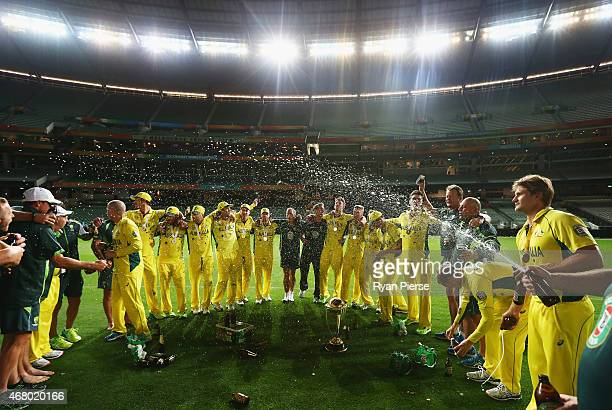 The Australian Team celebrate on the ground at 215am after the 2015 ICC Cricket World Cup final match between Australia and New Zealand at Melbourne...