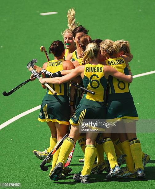 The Australian team celebrate scoring a goal during the Women's Semifinal match between Australia and England at Major Dhyan Chand National Stadium...