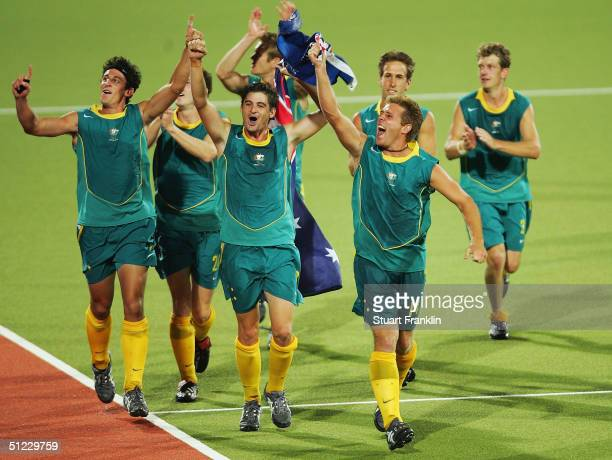 The Australian team celebrate winning gold in the men's field hockey gold medal match against the Netherlands on August 27 2004 during the Athens...
