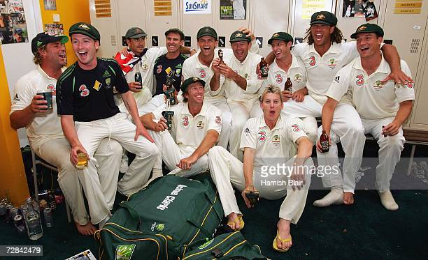 The Australian team celebrate with a replica Ashes Urn in the changing rooms after day five of the third Ashes Test Match between Australia and...