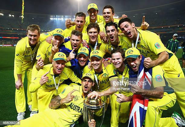 The Australian Team celebrate with the trophy after the 2015 ICC Cricket World Cup final match between Australia and New Zealand at Melbourne Cricket...