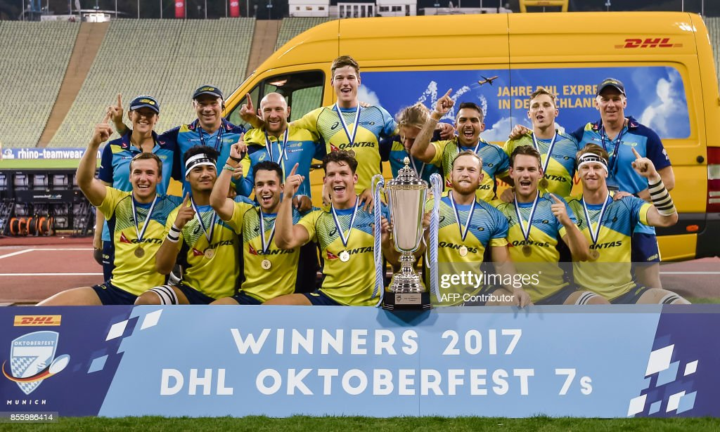 The Australian team celebrate with the trophy after the final match, Fiji vs Australia, at the Rugby Oktoberfest7s in Munich, southern Germany on September 30, 2017. The German Rugby Union is hosting a major rugby sevens tournament for the first time in Munich on Sept 29 and 30 called the Oktoberfest 7s. / AFP PHOTO / Guenter SCHIFFMANN