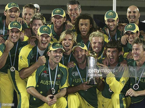 The Australian team celebrate with the trophy after the final of the ICC Champions Trophy between Australia and the West Indies at The Brabourne...