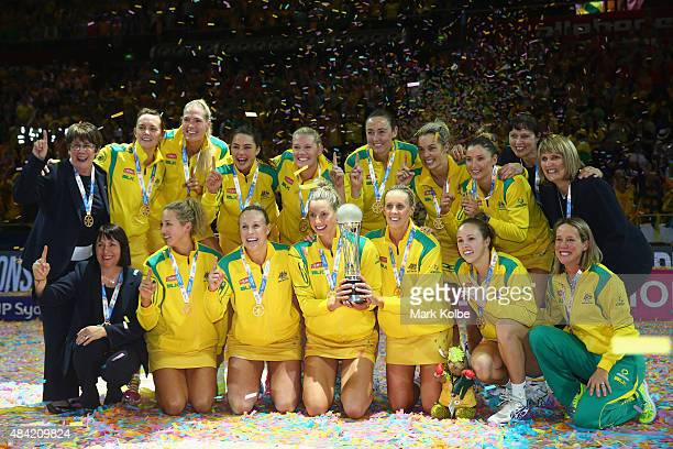 The Australian team celebrate with the trophy after victory during the 2015 Netball World Cup Gold Medal match between Australia and New Zealand at...
