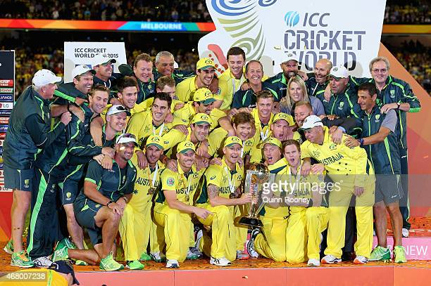 The Australian team celebrate with the trophy after winning the 2015 ICC Cricket World Cup final match between Australia and New Zealand at Melbourne...