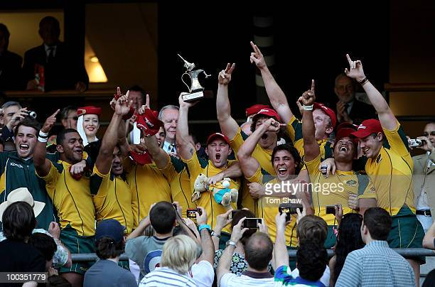 The Australian team celebrate with the trophy after winning the Cup Final match between Australia and South Africa during day two of the IRB London...