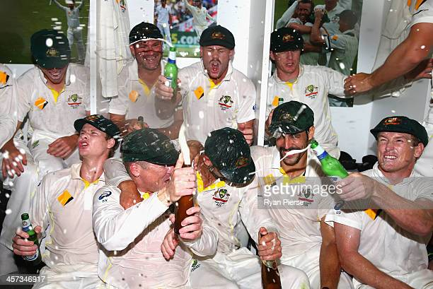 The Australian team celebrates victory in the change rooms during day five of the Third Ashes Test Match between Australia and England at WACA on...