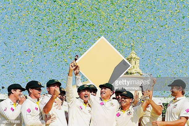The Australian team celebrates with the urn after winning the Ashes series 50 during day three of the Fifth Ashes Test match between Australia and...