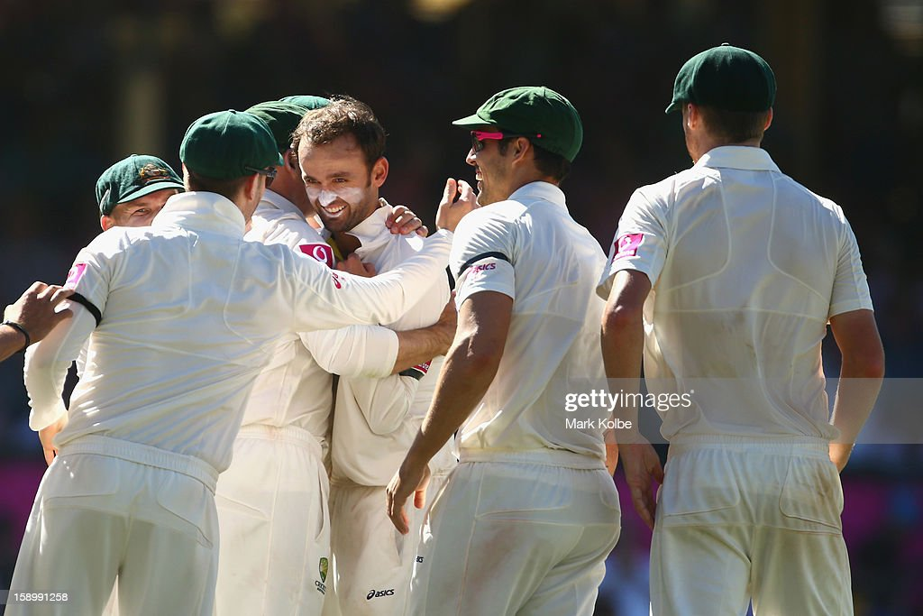 The Australian team congratulate Nathan Lyon of Australia after Michael Hussey of Australia caught Thilan Samaraweera of Sri Lanka during day three of the Third Test match between Australia and Sri Lanka at Sydney Cricket Ground on January 5, 2013 in Sydney, Australia.