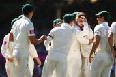 The Australian team congratulate Nathan Lyon of Australia after Michael Hussey of Australia caught Thilan Samaraweera of Sri Lanka during day three...