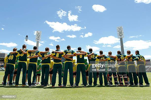 The Australian team embrace during the National Anthem during game one of the men's one day international series between Australia and South Africa...