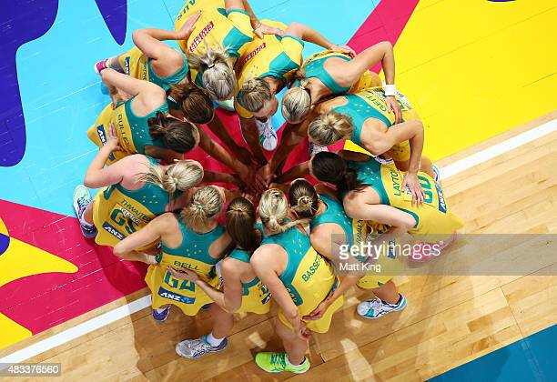 The Australian team forms a huddle before the 2015 Netball World Cup match between Australia and Barbados at Allphones Arena on August 8 2015 in...
