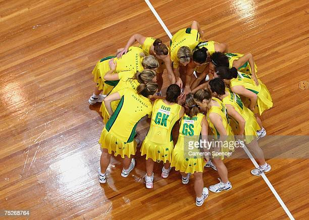 The Australian team huddle prior to the second Netball test series match between Australia and Jamaica at the State Sports Centre on July 8 2007 in...