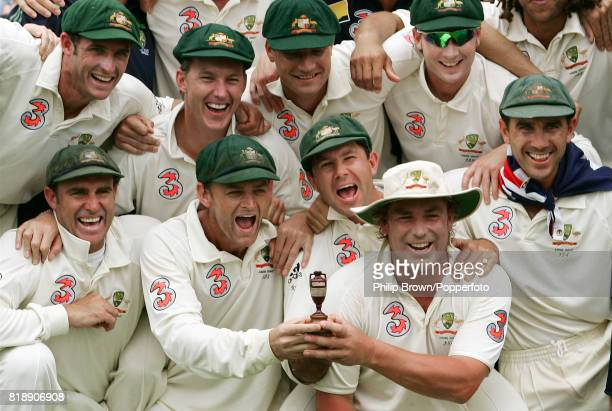 The Australian team including Matthew Hayden Adam Gilchrist Ricky Ponting Shane Warne and Justin Langer celebrate with a replica Ashes urn having...