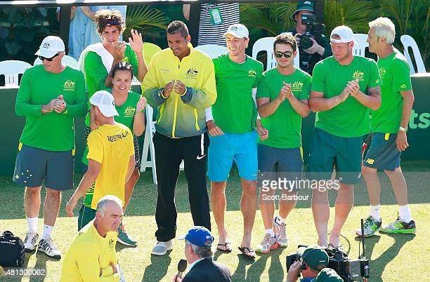 The Australian team including Sam Groth Thanasi Kokkinakis and Nick Kyrgios applaud as teammate Lleyton Hewitt of Australia leaves the court after...