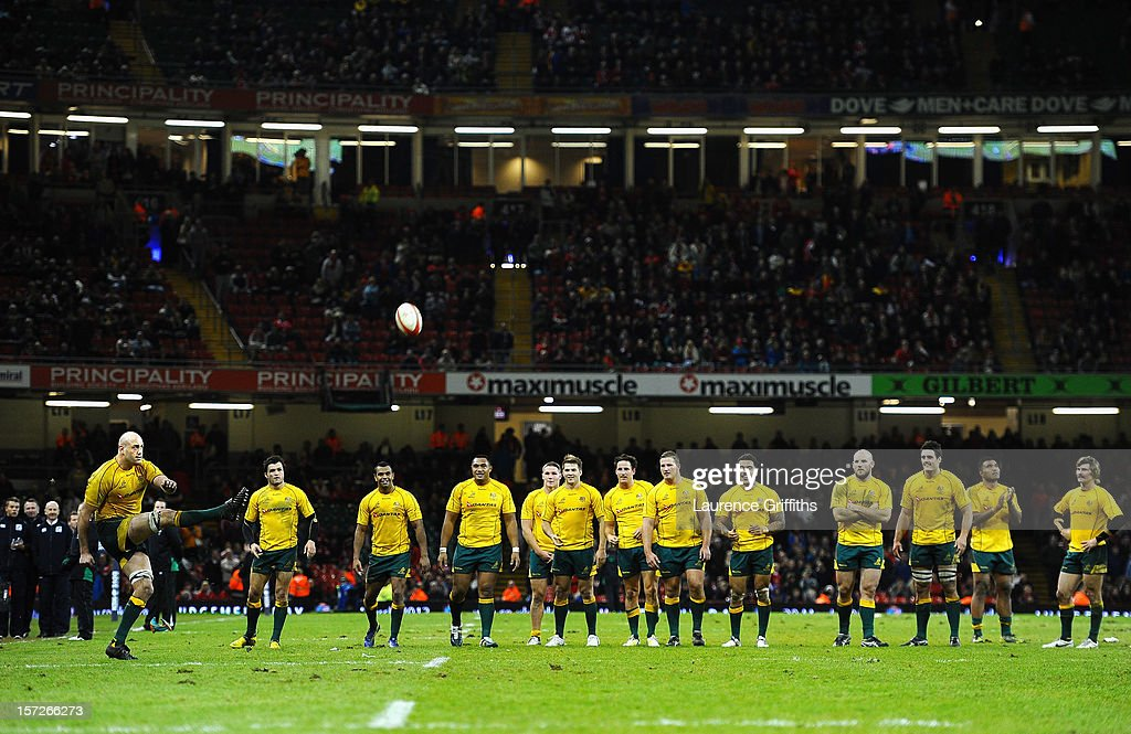 The Australian Team look on as <a gi-track='captionPersonalityLinkClicked' href=/galleries/search?phrase=Nathan+Sharpe&family=editorial&specificpeople=208152 ng-click='$event.stopPropagation()'>Nathan Sharpe</a> takes the final kick of the game during the International match between Wales and Australia at Millennium Stadium on December 1, 2012 in Cardiff, Wales.