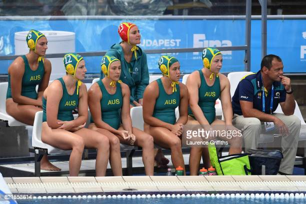The Australian team look on from the bench during the Women's Water Polo Quarterfinal against The United States on day eleven of the Budapest 2017...