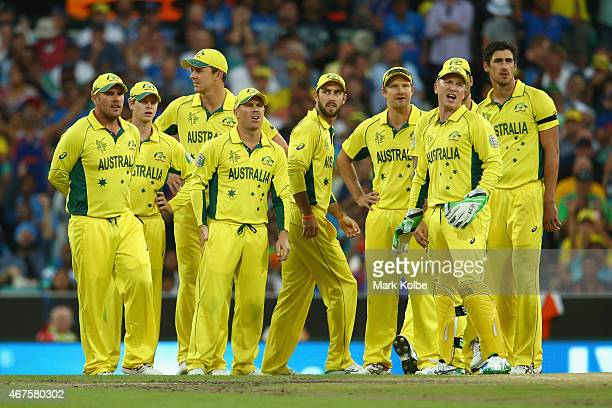 The Australian team looks dejected after umpires referred a catch off Rohit Sharma of India to the third umpire who ruled it was not out during the...