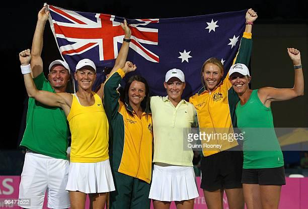 The Australian team of David Taylor Rennae Stubbs Casey Dellacqua Sam Stosur Alicia Molik and Nicole Bradtke celebrate winning their 2010 Fed Cup...