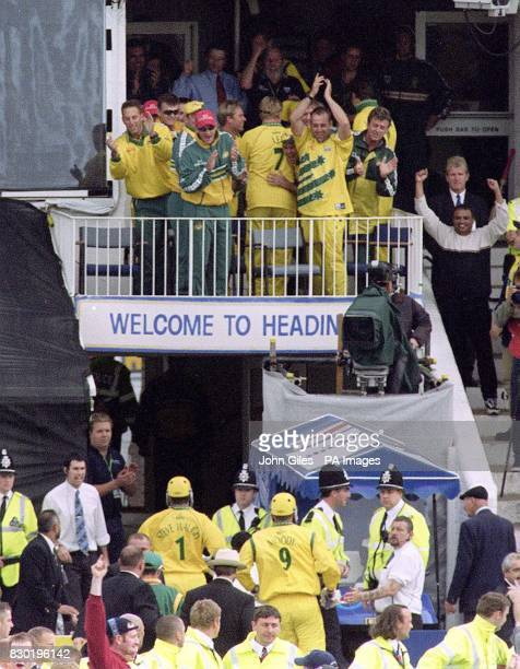 The Australian team on the balcony applaud their captain Steve Waugh and Tom Moody below after they beat South Africa in their Cricket World Cup...