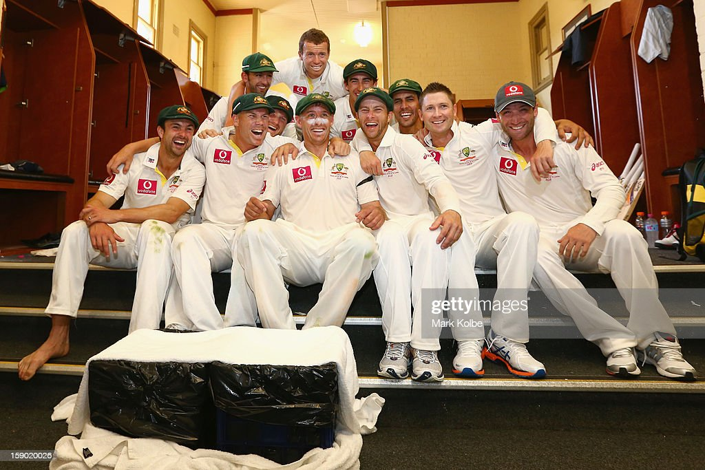 The Australian team pose in the change room as they celebrate winning the Warne–Muralidaran trophy on day four of the Third Test match between Australia and Sri Lanka at Sydney Cricket Ground on January 6, 2013 in Sydney, Australia.
